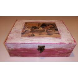 Caja joyero rosa y pluma.